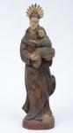 SANTO ANTONIO COM MENINO. Imagem em madeira policromada. Alt.: 43cm. Brasil - séc. XIX. Acompanha resplendor.